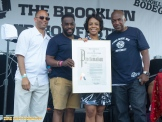 Wes Jackson founder of the Brooklyn Bodega poses for a portrait after receiving a Proclamation presented by Council Member Laurie Cumbo at the 11th Annual Brooklyn Hip-Hop Festival held at Williamsburg Park on July 11, 2015 in Brooklyn, NY. In the photo left to right, Congressman Hakeem Jeffries, Wes Jackson, Councilwoman Laurie Cumbo, dj Ralph McDaniels of the Video Music Box
