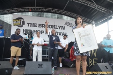 Council Member Laurie Cumbo (R) presents Wes Jackson (L) founder of the Brooklyn Bodega with a Proclimation for the Brooklyn Borough President at the 11th Annual Brooklyn Hip-Hop Festival held at Williamsburg Park on July 11, 2015 in Brooklyn, NY.