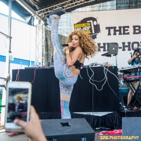 """Singer Jillian Hervey of Lion Babe performs at the 11th Annual Brooklyn Hip-Hop Festival held at Williamsburg Park on July 11, 2015 in Brooklyn, NY. She asked the crowd """"Can I Kick It?"""" from the Tribe Called Quest album, then kicks high in the air."""